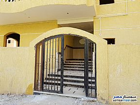 Apartment 7 bedrooms 4 baths 330 sqm without finish For Sale Districts 6th of October - 6