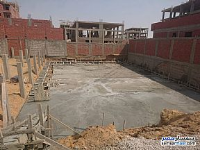 Apartment 3 bedrooms 2 baths 145 sqm without finish For Sale Badr City Cairo - 9