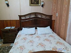 Apartment 2 bedrooms 1 bath 140 sqm super lux For Rent Mohandessin Giza - 10