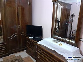 Apartment 2 bedrooms 1 bath 140 sqm super lux For Rent Mohandessin Giza - 8