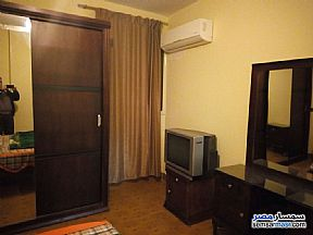 Apartment 2 bedrooms 1 bath 140 sqm super lux For Rent Mohandessin Giza - 6