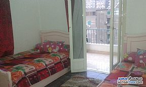 Apartment 2 bedrooms 1 bath 150 sqm super lux For Rent Mohandessin Giza - 12