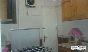 Apartment 2 bedrooms 1 bath 150 sqm super lux For Rent Mohandessin Giza - 10