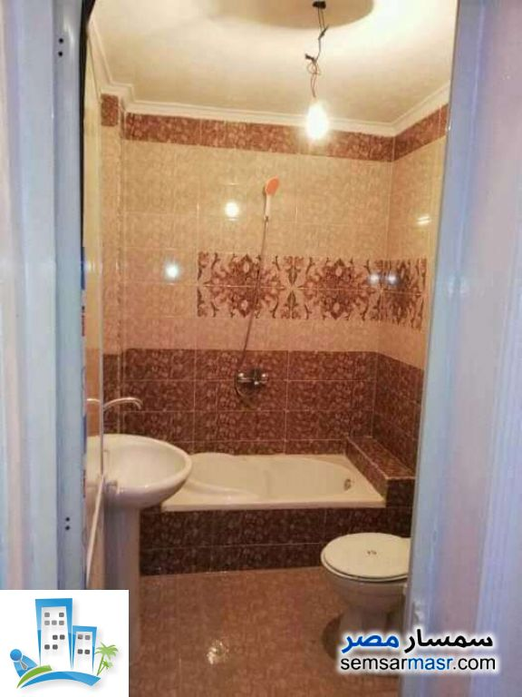 Apartment 2 bedrooms 1 bath 80 sqm super lux For Sale Ashgar City 6th of October - 3