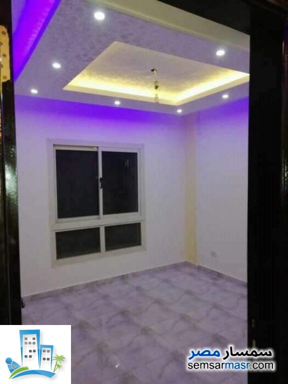 Apartment 2 bedrooms 1 bath 80 sqm super lux For Sale Ashgar City 6th of October - 5