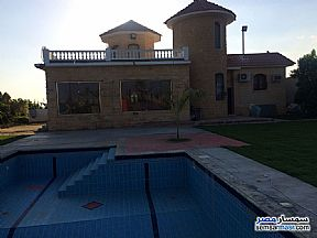 Villa 4 bedrooms 3 baths 25,200 sqm extra super lux For Sale Cairo Alexandria Desert Road Giza - 7