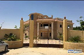 Villa 5 bedrooms 5 baths 4,200 sqm extra super lux For Sale Districts 6th of October - 3